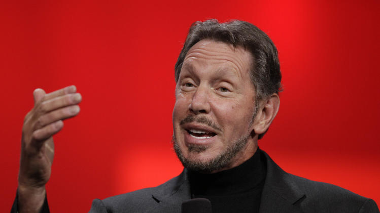 Oracle CEO Larry Ellison gestures while giving a keynote address at Oracle OpenWorld in San Francisco, Tuesday, Oct. 2, 2012. Ellison says he plans to turn the Hawaiian island that he recently bought into a laboratory for experimenting with more environmentally sound ways of living. Ellison says he hopes to convert sea water into fresh water on the 141-mile-square (365-square-kilometer) mile island of Lanai. He also wants more electric cars on the island and hopes to increase its fruit exports to Japan and other markets. (AP Photo/Eric Risberg)