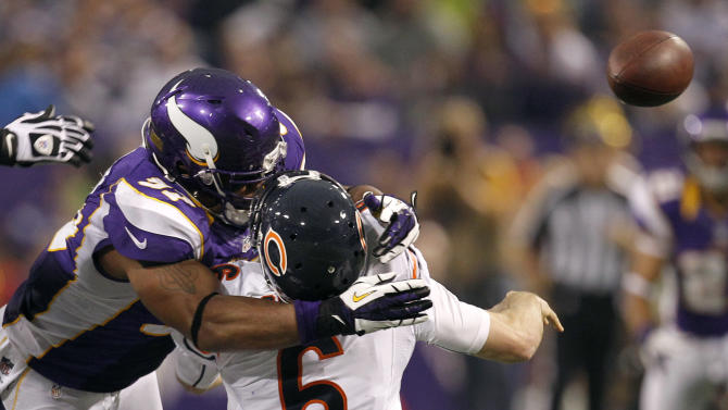 Chicago Bears quarterback Jay Cutler (6) gets hit by Minnesota Vikings defensive end Everson Griffen, left, after passing the ball during the second half of an NFL football game, Sunday, Dec. 9, 2012, in Minneapolis. Griffen was called for a personal foul on the play. (AP Photo/Genevieve Ross)