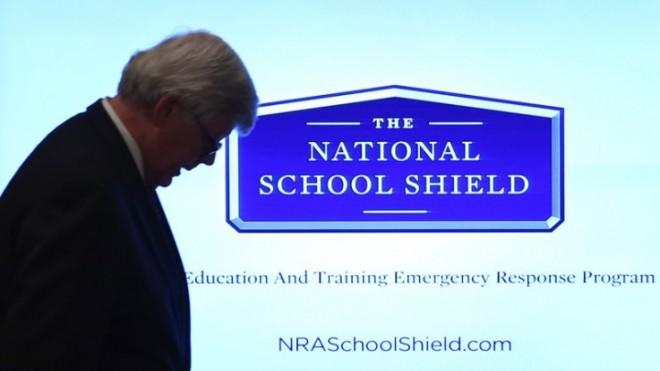 NRA President David Keene exits after refusing to take questions during a news conference on Dec. 21.