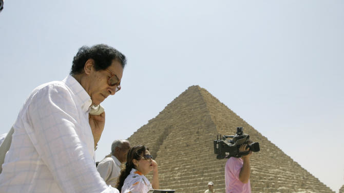 FILE - In this Monday, Aug. 11, 2008 file photo, then Egyptian minister of culture Farouq Hosni, left, takes a tour while unveiling a project to modernize the site of the ancient Giza Pyramids in Cairo, Egypt. Hosni, who served as culture minister for most of former President Mubarak's 29 year-rule has been charged with corruption and referred to trial according to Egypt's official news agency. Hosni allegedly failed to account for 18 million Egyptian pounds of his wealth during a Justice Ministry investigation. (AP Photo/Nasser Nasser, File)