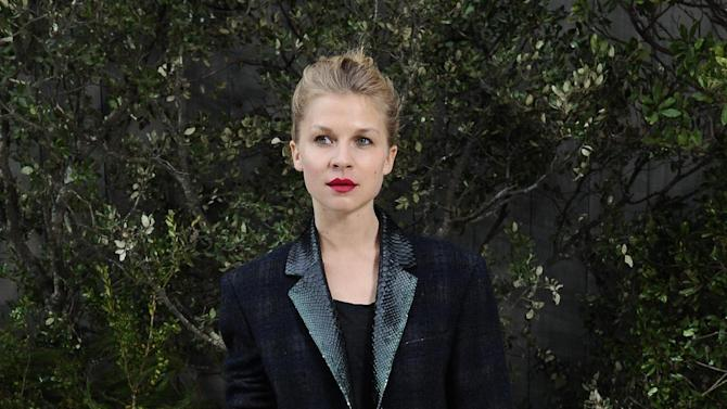 Clémence Poésy, French actress, attends the Chanel Spring/Summer 2013 Haute Couture fashion collection, in Paris, Tuesday, Jan. 22, 2013. (AP Photo/Zacharie Scheurer)