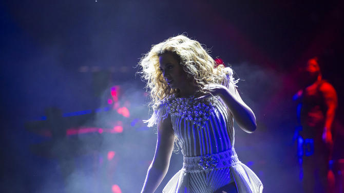 Singer Beyonce performs on stage during her Mrs. Carter Show World Tour 2013, on Friday, May 17, 2013, at the Hallenstadion in Zurich, Switzerland. Beyonce is wearing a custom, hand beaded white peplum one-piece by designers Ralph & Russo. Hosiery provided by Capezio. (Photo by Yosra El-Essawy/Invision for Parkwood Entertainment/AP Images)