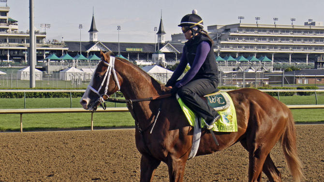 Kentucky Derby hopeful Will Take Charge, with exercise rider Taylor Carty aboard, walks the wrong way on the race track at Churchill Downs, Sunday, April 28, 2013, in Louisville, Ky. (AP Photo/Garry Jones)