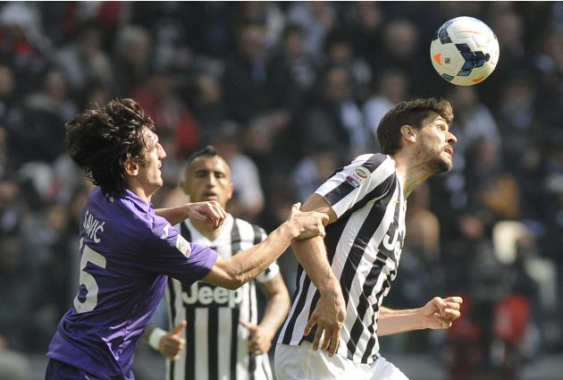 Juventus' Fernando Llorente fights for the ball with Fiorentina's Stefan Savic during their Italian Serie A soccer match in Turin
