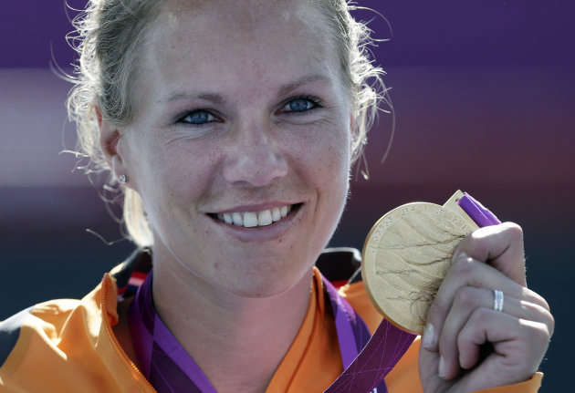 Esther Vergeer of the Netherlands holds her gold medal for winning the women's wheelchair tennis final at the 2012 Paralympics games, Friday, Sept. 7, 2012, in London. Vergeer defeated Aniek Van Koot