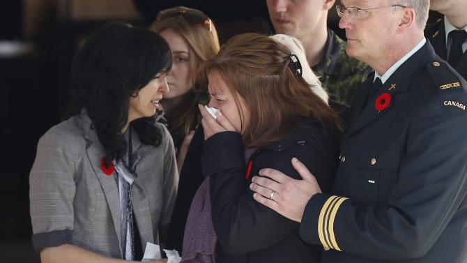 The mother of Cpl. Nathan Cirillo reacts as his casket is placed in a hearse at a funeral home in Ottawa