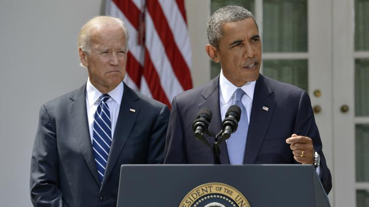 U.S. President Barack Obama speaks next to Vice President Joe Biden at the Rose Garden of the White House