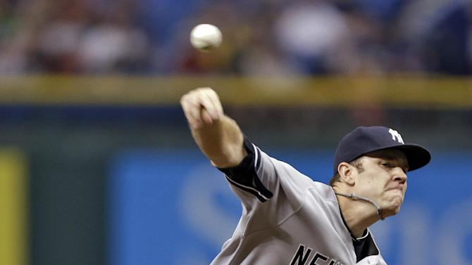 New York Yankees relief pitcher David Phelps delivers to Tampa Bay Rays' Matt Joyce during the first inning of a baseball game on Friday, May 24, 2013, in St. Petersburg, Fla. (AP Photo/Chris O'Meara)