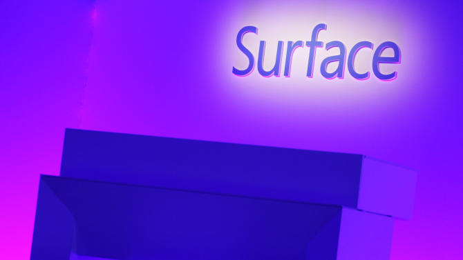 The Surface logo is illuminated on a stage prior to the introduction Microsoft's new Surface tablet computer, Monday, Sept. 23, 2013 in New York. Microsoft is introducing new Surface tablet computers and accessories, including a professional model that allows people to use it more like a laptop or a desktop. (AP Photo/Mark Lennihan)