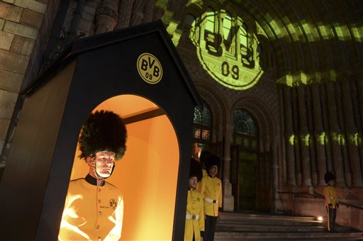 Actors in mock uniforms guard Borussia Dortmund's party at the Natural History Museum in London, England, Sunday morning May 26,  2013. Borussia Dortmund lost the Champions League final soccer match a