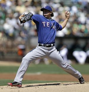 Holland stellar over 8 innings in 4-0 Rangers win