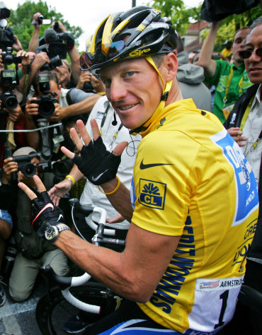 FILE - In this July 24, 2005, file photo, Lance Armstrong gestures for his seventh straight win in the Tour de France cycling race before the final stage between Corbeil-Essonnes, south of Paris, and the French capital. In 2005, Armstrong was also named Associated Press Male Athlete of the Year and ESPN's ESPY Award for Best Male Athlete. He later announced what would be a temporary retirement from cycling in 2005. (AP Photo/Peter Dejong, File)