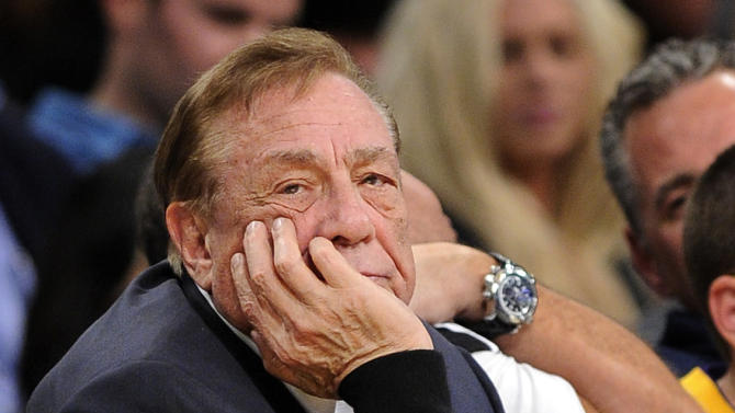 In this Feb. 25, 2011, file photo, Los Angeles Clippers owner Donald Sterling looks on during the first half of their NBA basketball game against the Los Angeles Lakers in Los Angeles. Sterling could use lawyers and lawsuits to challenge the NBA's plan to force him out over recent racist comments, but legal experts say the league would likely prevail in the end. Sports law experts say the NBA's constitution gives its Board of Governors broad latitude in league decisions including who owns the teams. NBA Commissioner Adam Silver wants a swift vote against Sterling, which requires a minimum of three-fourths of the other 29 controlling owners to agree