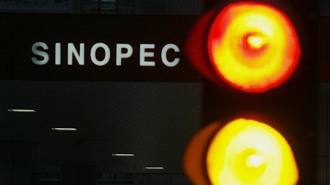 A Sinopec gas station is seen behind traffic lights in Hong Kong