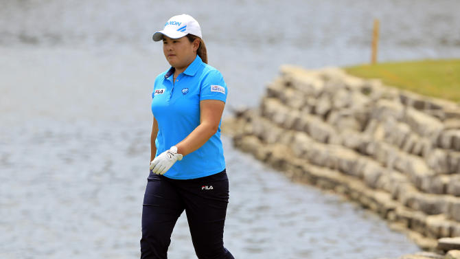 Inbee Park, of South Korea, walks to the 18th green to survey a shot during the first round of the North Texas LPGA Shootout golf tournament, Thursday, April 25, 2013 at Los Colinas Country Club in Irving, Texas. She finished the day at 4-under-par. (AP Photo/John F. Rhodes)