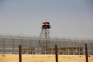 An observation tower painted in the colours of the Egyptian national flag is seen near the Nitzana crossing, along Israel's border with Egypt's Sinai desert