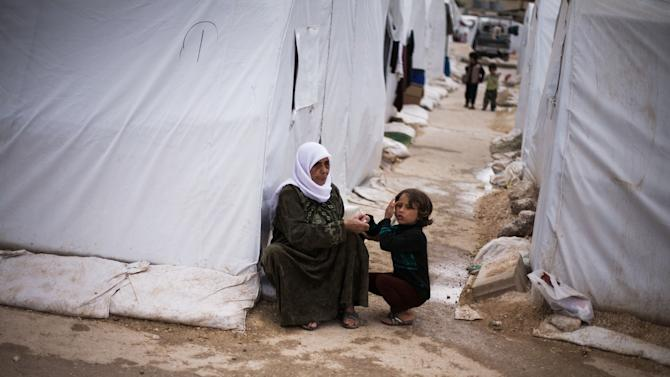 A Syrian displaced woman and her granddaughter are seen in a refugee camp near Azaz, Syria, Tuesday, Oct. 23, 2012. (AP Photo/ Manu Brabo)