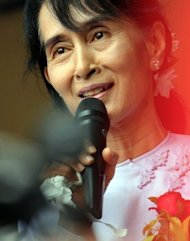 Myanmar opposition leader Aung San Suu Kyi speaks to journalists and supporters at her National League for Democracy headquarters in Yangon on April 2. Tokyo will waive Myanmar's 300 billion yen ($3.7 billion) debt and resume suspended assistance to the country, the Japanese government said Saturday