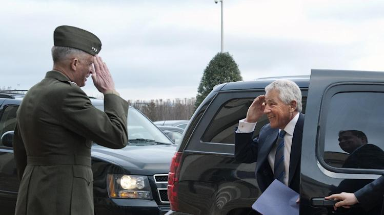 Former Sen. Chuck Hagel, R-Neb., salutes Marine Corp. Lt. Gen. Tom Waldheuser as he arrives at the Pentagon to be sworn-in as Secretary of Defense, in Arlington, Va., Wednesday, Feb. 27, 2013. Waldheuser will be Hagel's Senior Military Assistant. (AP Photo/Cliff Owen)
