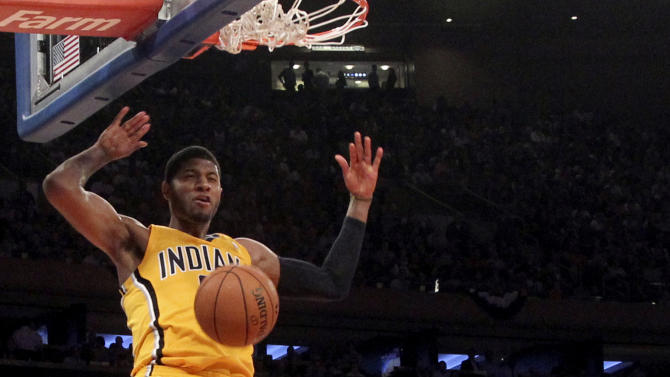 New York Knicks' Iman Shumpert (21) reacts as Indiana Pacers' Paul George dunks in the first half of Game 2 of their NBA basketball playoff series in the Eastern Conference semifinals at Madison Square Garden in New York, Tuesday, May 7, 2013. (AP Photo/Mary Altaffer)