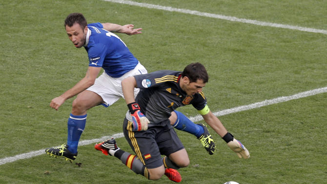Italy's Antonio Cassano fouls Spain goalkeeper Iker Casillas during the Euro 2012 soccer championship Group C match between  Spain and Italy in Gdansk, Poland, Sunday, June 10, 2012. (AP Photo/Gero Breloer)