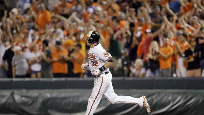 Baltimore Orioles' Matt Wieters rounds the bases after hitting a solo home run in the 11th inning of an interleague baseball game against the Atlanta Braves, Monday, July 27, 2015, in Baltimore. Baltimore won 2-1 in 11 innings. (AP Photo/Patrick Semansky)