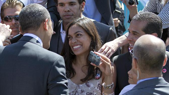 Actress Rosario Dawson, center and Los Angeles Mayor Mayor Antonio Villaraigosa, right greet President Barack Obama at the Cesar E. Chavez National Monument, Monday, Oct. 8, 2012, in Keene, Calif. (AP Photo/Carolyn Kaster)