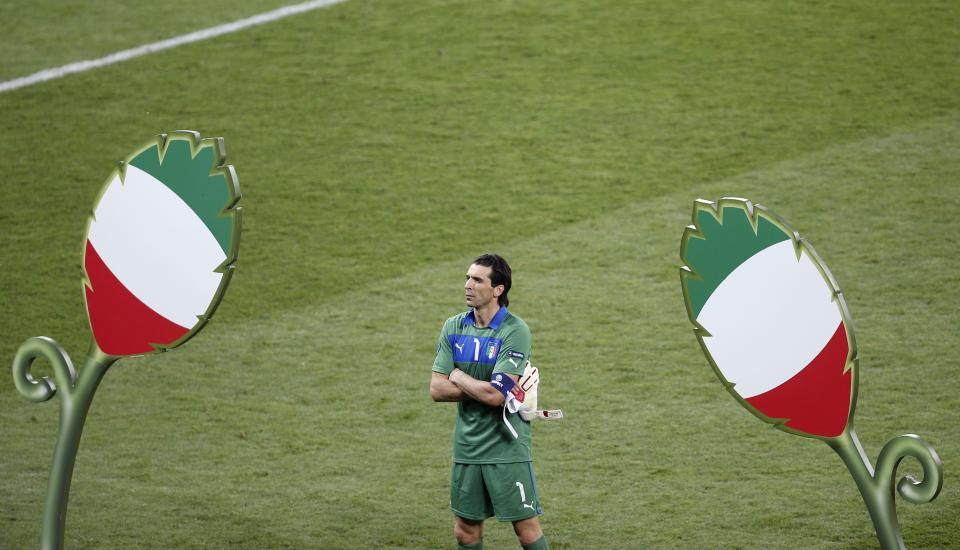 Italy goalkeeper Gianluigi Buffon reacts after losing the Euro 2012 soccer championship final  between Spain and Italy in Kiev, Ukraine, Sunday, July 1, 2012. (AP Photo/Darko Vojinovic)