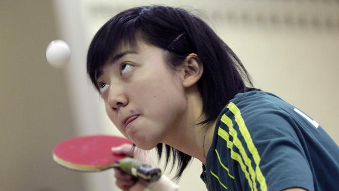 In this picture taken July 10, 2012,  Chinese born table tennis player Gui Lin practices as she prepares for the London Olympic games in Santo Andre, outskirts of Sao Paulo, Brazil. At 12, Gui moved to Brazil, and few months ago, at 18, she earned Brazilian citizenship and will participate in the Olympics playing for the Brazilian table tennis team. (AP Photo/Andre Penner)