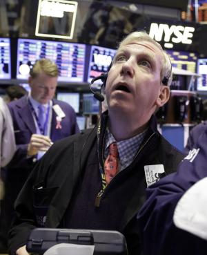 Trader Richard Cohen works on the floor of the New York Stock Exchange Wednesday, March 13, 2013. Stocks are mixed in early trading on Wall Street after the government reported that U.S. retail sales rose at the fastest pace in five months. (AP Photo/Richard Drew)