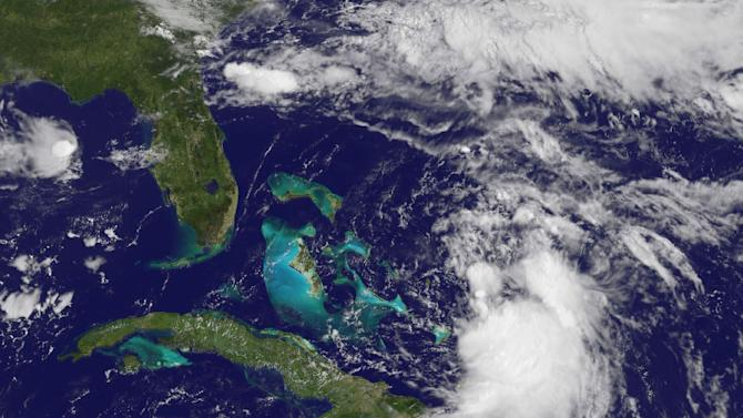 Tropical Storm Cristobal(lower right)form near the Bahamas on August 24, 2014
