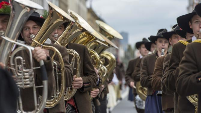 A brass band dressed in traditional Bavarian clothes takes part in the Oktoberfest parade in Munich