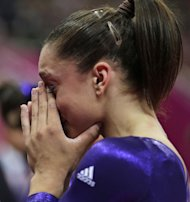 U.S. gymnast Jordyn Wieber cries after she failed to qualify for the women&#39;s all-around finals during the Artistic Gymnastics women&#39;s qualification at the 2012 Summer Olympics, Sunday, July 29, 2012, in London. (AP Photo/Gregory Bull)