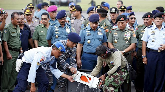 File photo of flight data recorder of AirAsia QZ8501 being transferred to another container at the airbase in Pangkalan Bun