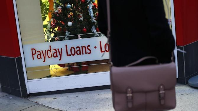 A payday loans sign is seen in the window of Speedy Cash in northwest London