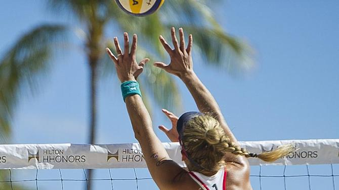 IMAGE DISTRIBUTED FOR HILTON HHONORS - In this photograph released on Monday, Oct. 29, 2012, Team USA athlete April Ross and Team China athlete Zhang Xi compete during an exhibition match at the Hilton HHonors Beach Volleyball Challenge, hosted by Hilton HHonors and USA Volleyball on Saturday, Oct. 20, 2012 at the Hilton Hawaiian Village Waikiki Beach Resort. The match will broadcast on Saturday, Dec. 1, 2012 on NBC Sports Network. (Lucy Pemoni/AP Images for Hilton HHonors)