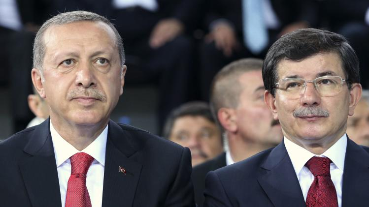 Turkey's Prime Minister Tayyip Erdogan and Foreign Minister Ahmet Davutoglu attend the Extraordinary Congress of AKP in Ankara