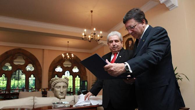 Cyprus President Dimitris Christofias, left, and European Commission President Jose Manuel Barroso seen at the Presidential Palace, in Nicosia, Cyprus, Friday, July 6, 2012. Cyprus took over the six-month, rotating EU Presidency from Denmark on July 1st, 2012. (AP Photo/Philippos Christou)