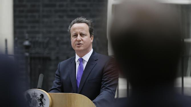 Britain's Prime Minister David Cameron speaking to the media outside 10 Downing Street in London, Thursday, May  23, 2013. The British government's emergency committee met Thursday after two attackers butchered a British soldier in a daylight attack in London that raised fears terrorism had returned to the capital. Prime Minister David Cameron says there are strong indications it was an act of terrorism, and his top advisers will be examining the potential security implications of the attack, which took place near a military barracks in the Woolwich area of the city. Police Thursday confirmed the dead man was a serving soldier and said his identity will not be released yet at his family's request. They said a post-mortem examination will be conducted later Thursday.(AP Photo/Alastair Grant)
