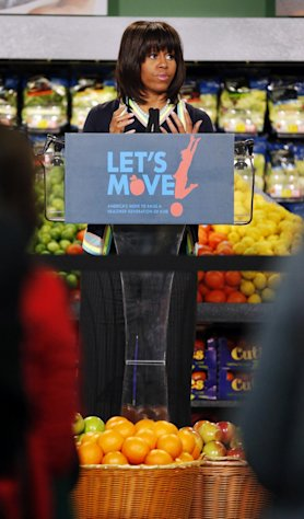 "First lady Michelle Obama at a Walmart Neighborhood Market in Springfield, Mo., Thursday, Feb. 28, 2013. Obama was promoting her campaign against childhood obesity and highlight ""the groundbreaking steps"" the retailer has taken to make healthy food more affordable. (AP Photo/Orlin Wagner)"