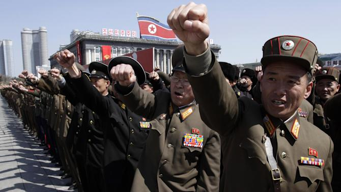North Korean army officers punch the air as they chant slogans during a rally at Kim Il Sung Square in downtown Pyongyang, North Korea, Friday, March 29, 2013. Tens of thousands of North Koreans turned out for the mass rally at the main square in Pyongyang in support of their leader Kim Jong Un's call to arms. (AP Photo/Jon Chol Jin)