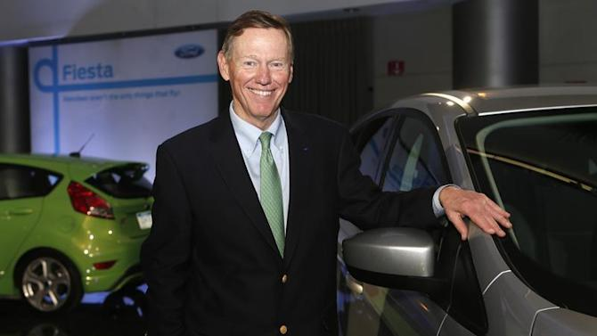 Ford Motor Co. CEO Mulally poses next to Ford vehicle during gathering with members of media at Ford Conference Center in Dearborn