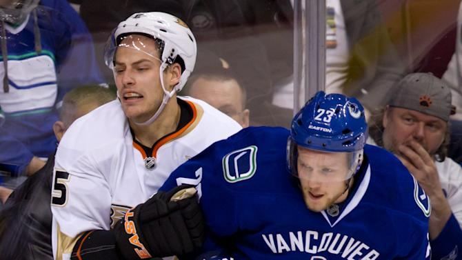 Vancouver Canucks' Alexander Edler, right, of Sweden, hits Anaheim Ducks' Ryan Getzlaf during the second period of an NHL hockey game in Vancouver, British Columbia, Sunday, Jan. 15, 2012. (AP Photo/The Canadian Press, Darryl Dyck)