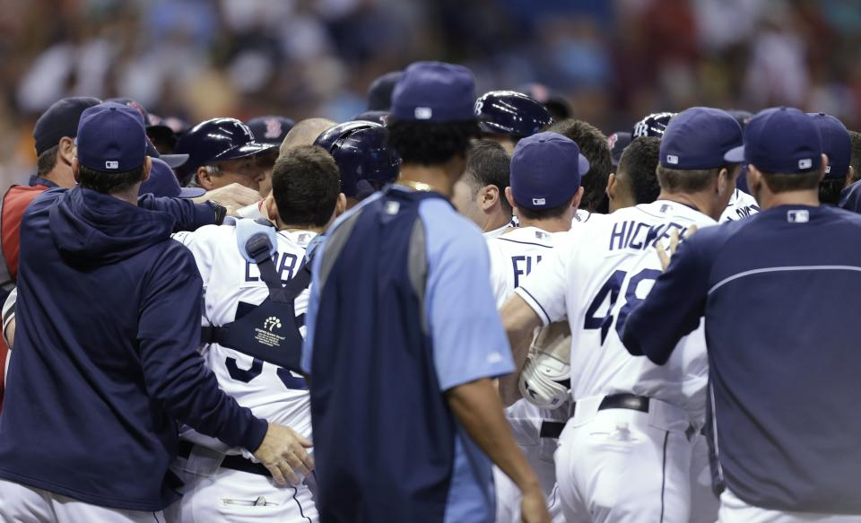 Benches empty after Tampa Bay Rays' Matt Joyce was hit with a sixth-inning pitch from Boston Red Sox starting pitcher John Lackey during a baseball game Monday, June 10, 2013, in St. Petersburg, Fla. (AP Photo/Chris O'Meara)