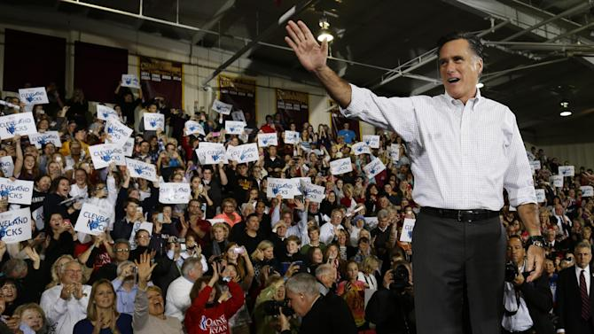 Republican presidential candidate, former Massachusetts Gov. Mitt Romney waves to supporters as he takes the stage at a campaign stop at Avon Lake High School in Avon Lake, Ohio, Monday, Oct. 29, 2012. (AP Photo/Charles Dharapak)
