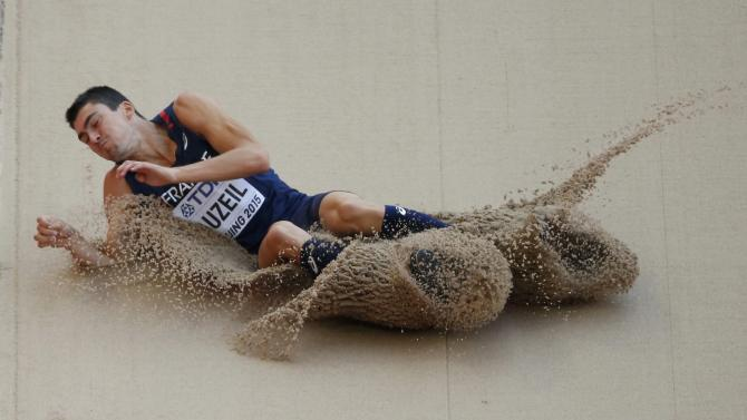 Auzeil of France competes in the men's decathlon long jump event  at 15th IAAF World Championships in Beijing