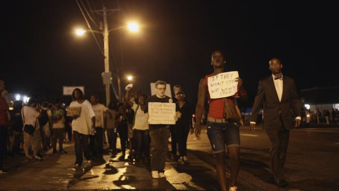 Demonstrators protest the shooting death of Michael Brown on August 20, 2014 in Ferguson, Missouri