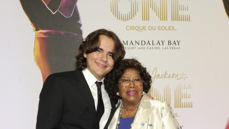 "Prince Jackson, left, and Katherine Jackson arrives at the world premiere of ""Michael Jackson ONE"" at THEhotel at Mandalay Bay Resort and Casino on Saturday, June 29, 2013 in Las Vegas. (Photo by David Becker/Invision/AP)"