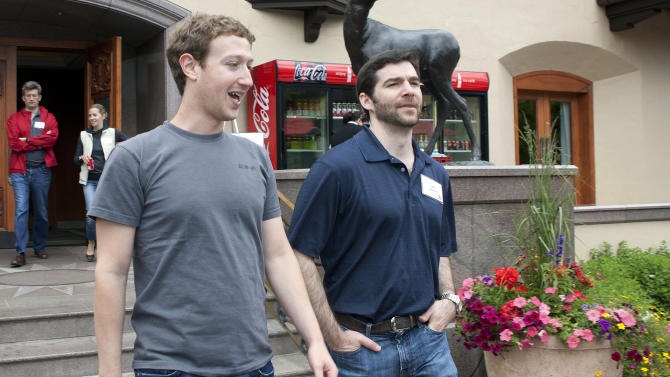 Facebook CEO Mark Zuckerberg, left, walks with Jeff Weiner, CEO of LinkedIn at the Sun Valley Inn during the 2011 Allen and Co. Sun Valley Conference, Thursday, July 7, 2011, in Sun Valley, Idaho (AP Photo/Julie Jacobson)