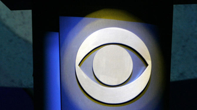 FILE - In this Jan. 9, 2007 file photo, a CBS Corp. logo is silhouetted in Las Vegas.  CBS reports its fourth quarter earnings on Thursday, Feb. 14, 2013. (AP Photo/Jae C. Hong, File)